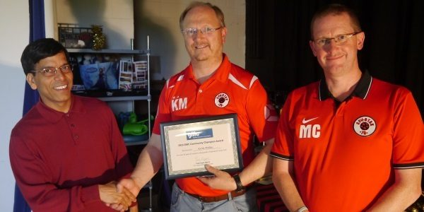 Prem presenting Keith Mullins, Secretary of Spartak78 Youth Club, with a GMC Community Champion Award